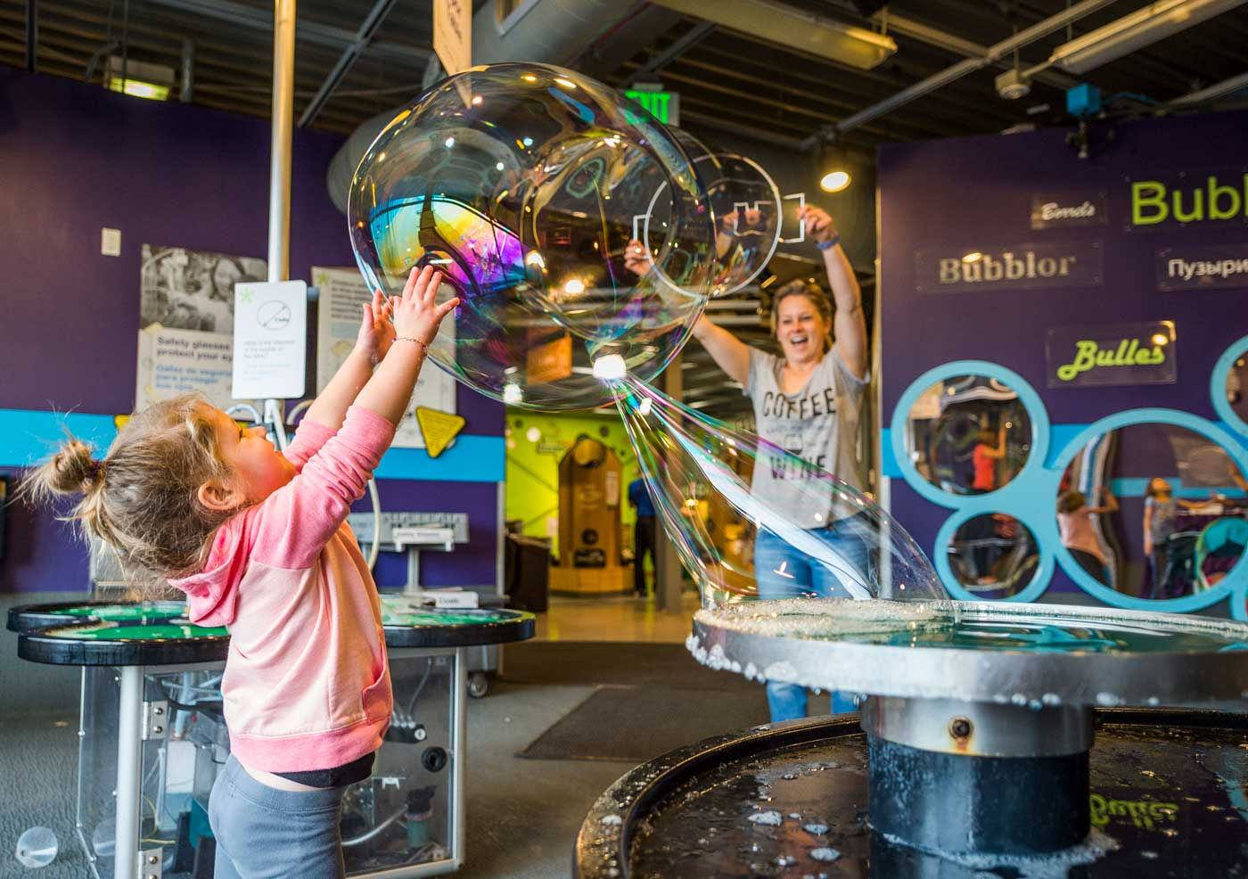 Woman and child playing at the bubble exhibition at the Children's Museum of Denver