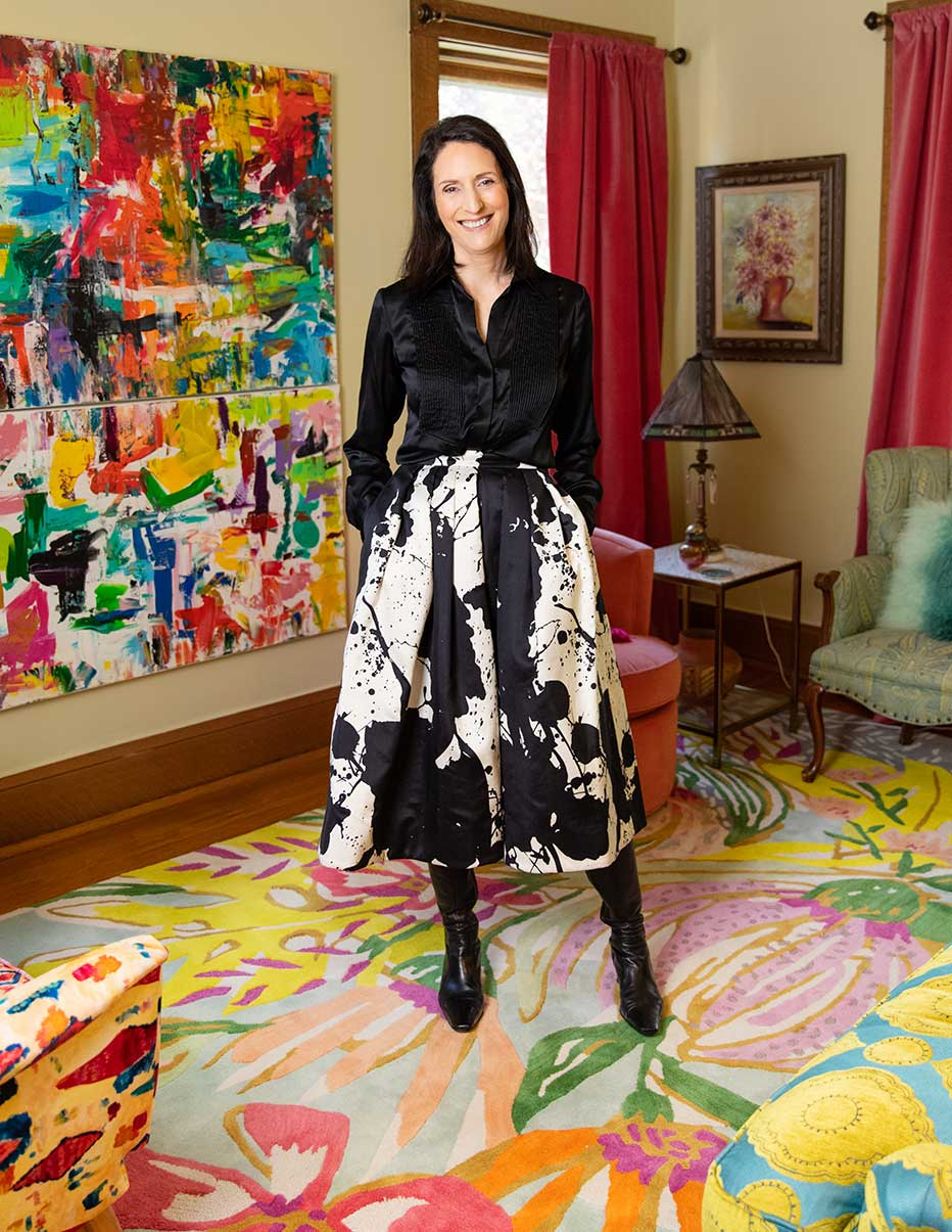 Karla Raines standing in her artistic living room