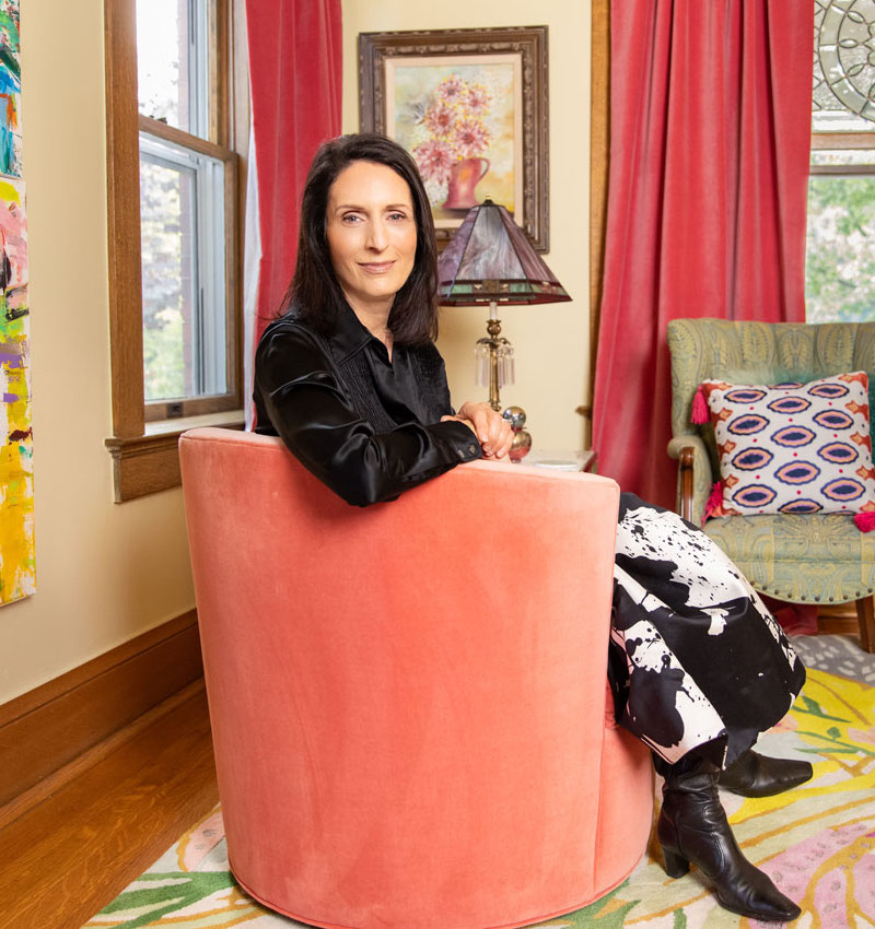 Karla Raines sitting in chair in artistic living room